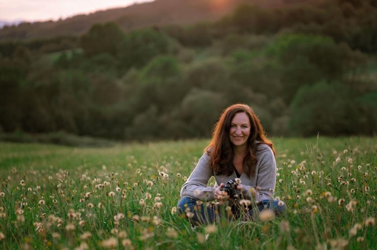 Karolina Grabara photographer in a field