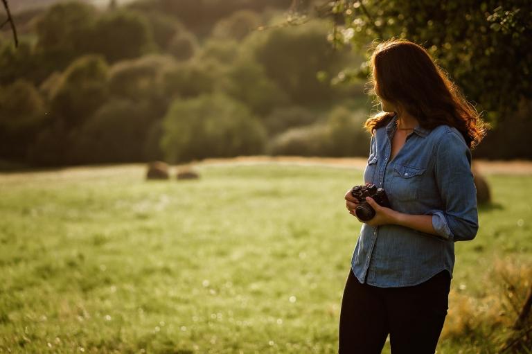 Karolina Grabara photographer in nature at sunset